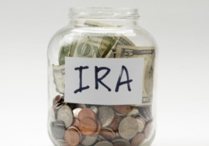 A jar with money saying IRA