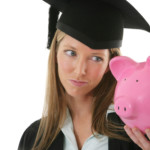 Student looking at piggy bank