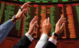 hands raised trading stocks