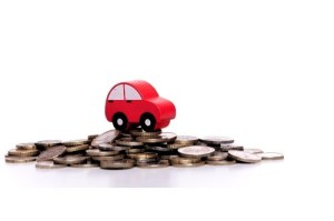 Car on top of pile of coins